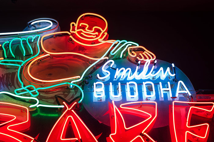Smiling Buddha sign