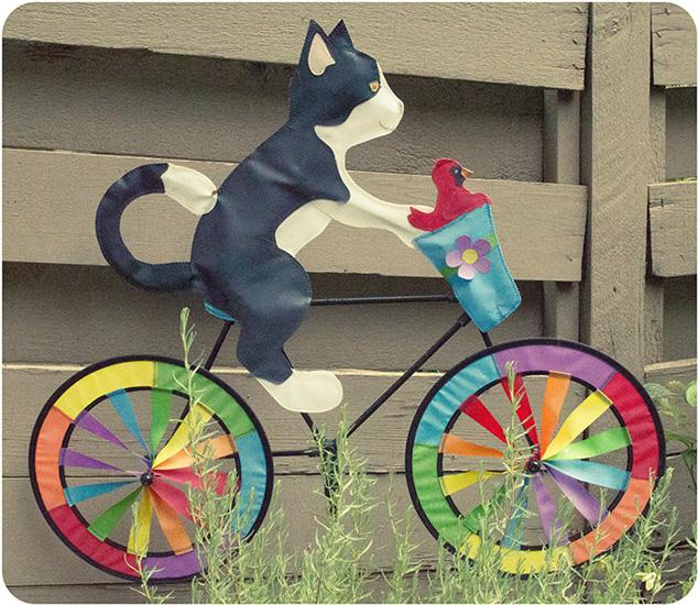 Cat on a bike in the garden